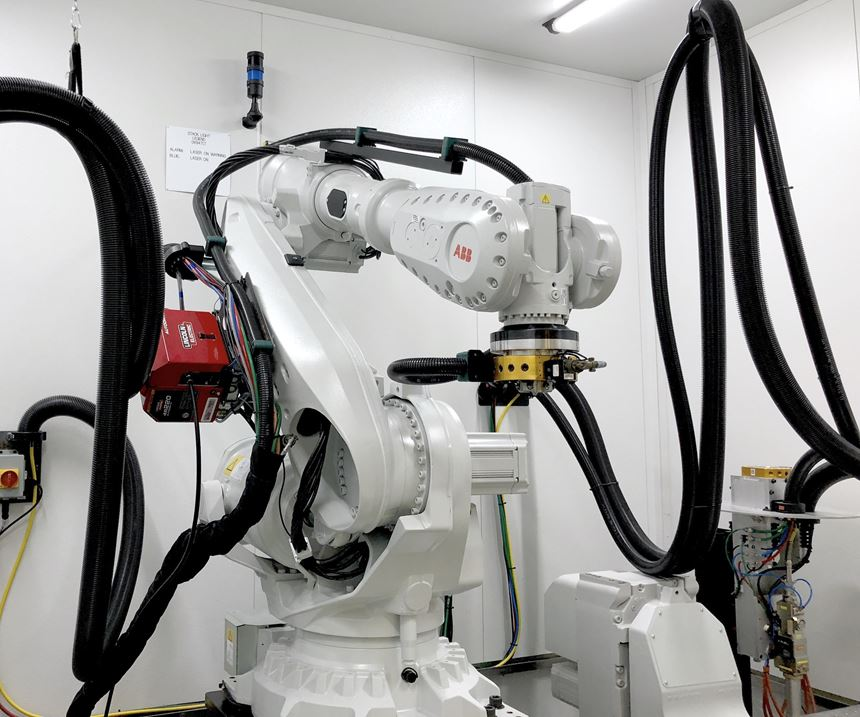 multi-axis ABB robot performing metal deposition 3D printing
