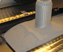 powder metal in an additive manufacturing machine