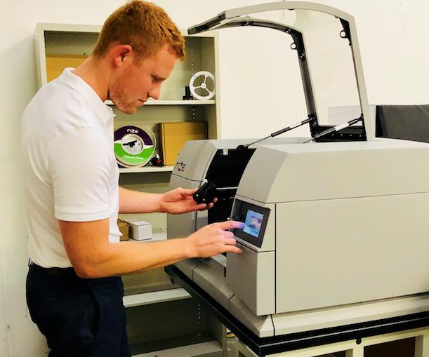 PSMI employee using Rize 3D printer