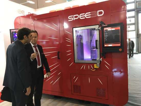 two people looking at spee3d machine