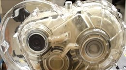 A combination of weight reduction and stiff gear shape shape achieved a more efficient transmission. Lubrication tests with RP plastic gear were then performed.