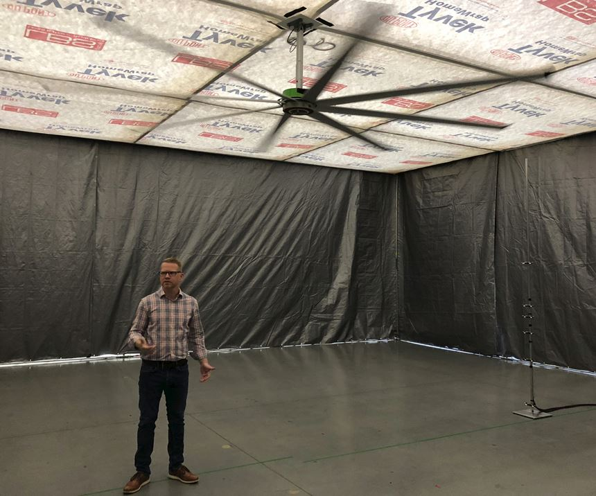 Jay Fizer, R&D Manager, Big Ass Fans, under fan in the smaller chamber