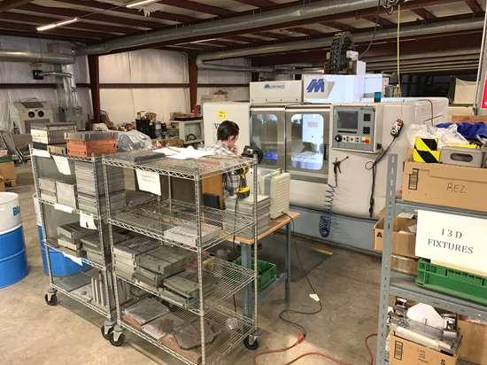 Build plate refinishing station