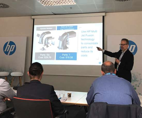 Philipp Jung, chief strategy officer, HP, shows an air intake part