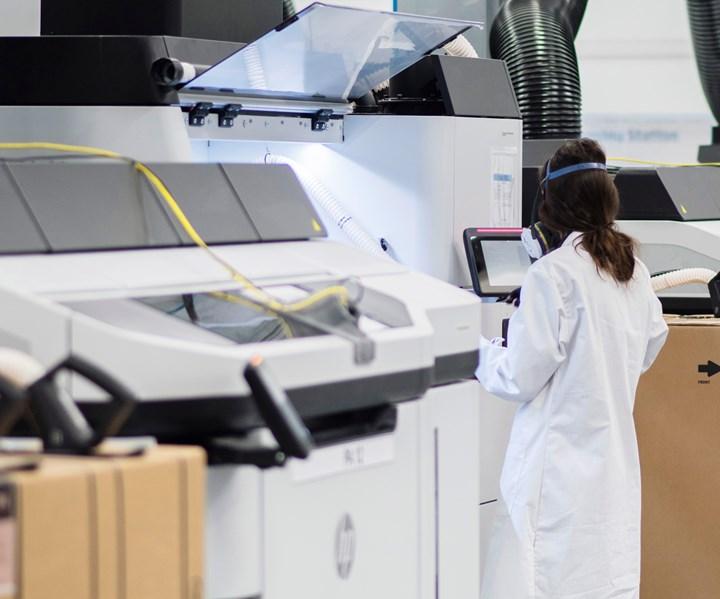 technician working on 5200 HP MJF printer