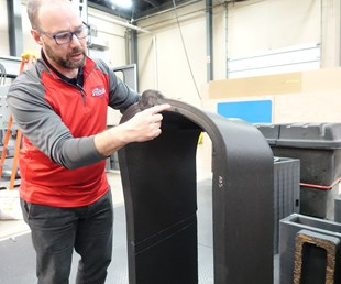 Jason Susnjara, vice president of marketing, Thermwood, with tool 3d printed for Boeing
