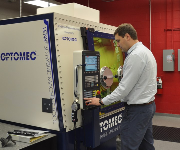 Dr. Mike Sealy, University of Nebraska-Lincoln, with Optomec LENS 860 hybrid manufacturing system