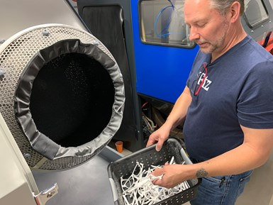 Will Hallewell, additive manufacturing lead, Fitz Frames removes frames from bead blaster