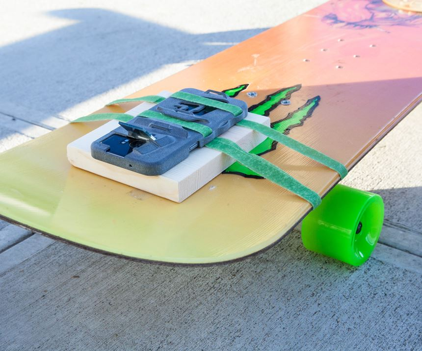 Periscope Case strapped to skateboard
