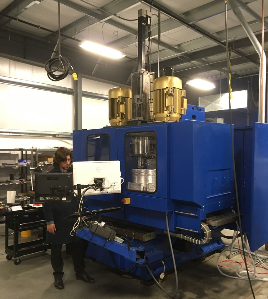 MELD machine looks and operates much like a CNC machine tool
