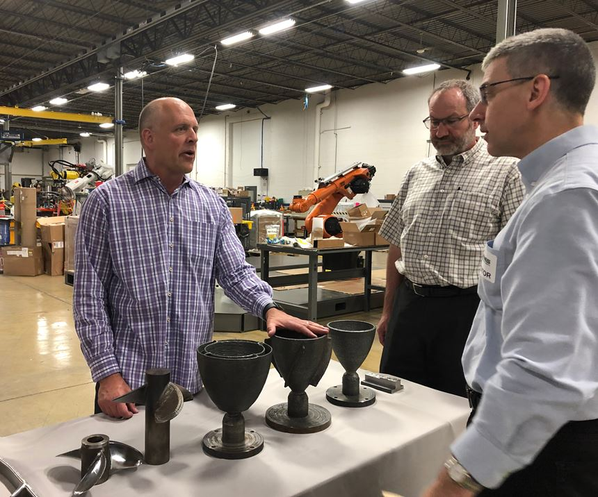 Addere president Scott Woida discusses sample parts made using the robot AM system