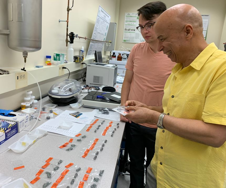 Dr. Ahmed El-Ghannam examines samples that have been used to validate the crystal-growth method of bonding SiC