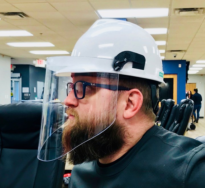 hard hat with 3D printed adapters and face shield