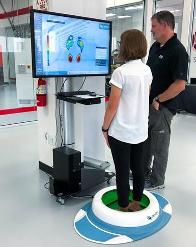 subject having feet measured by the Albert scanner