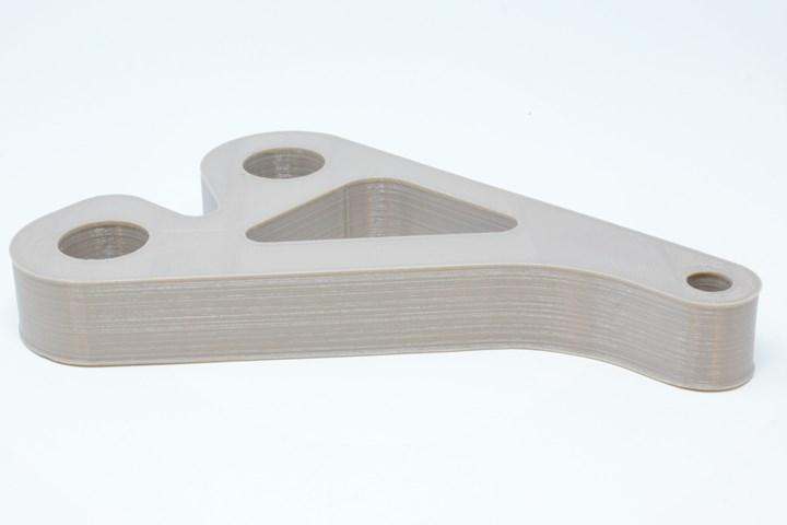 Rounded corners, such as those in this 3D printed bracket made of PEEK, help reduce build time in High Speed Extrusion.