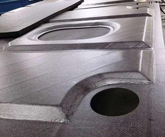 Janicki Industries carbon fiber composite part.