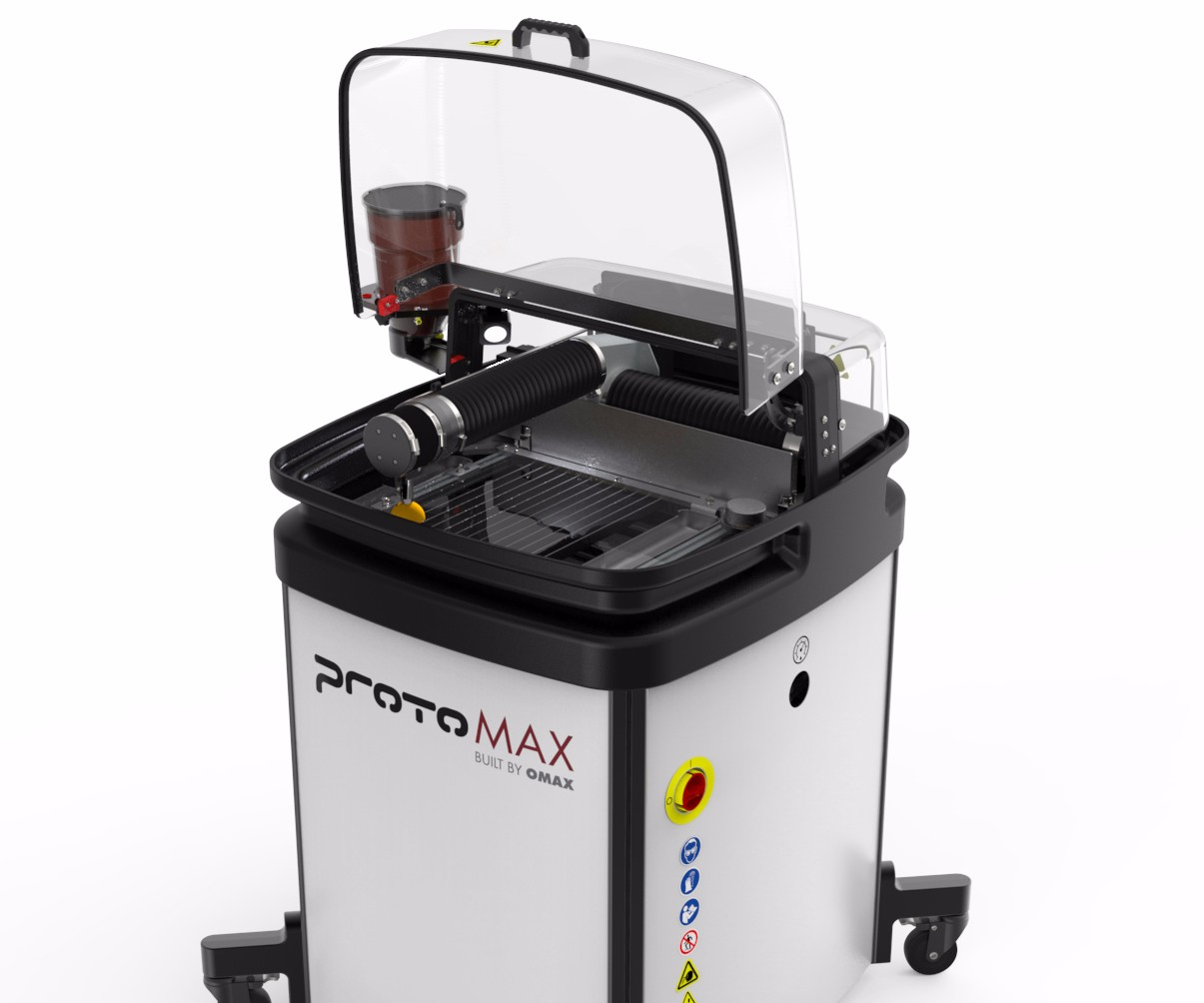 OMAX ProtoMAX compact waterjet cutting machine.