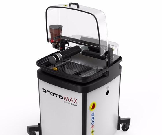 OMAX ProtoMAX compact waterjet cutting machine.