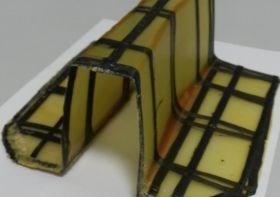 Glass fiber part with local carbon fiber UD patches iComposite 4.0 project AZL Schuler press