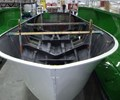 Carbon fiber epoxy resin infusion in production boats Hinckley Yachts