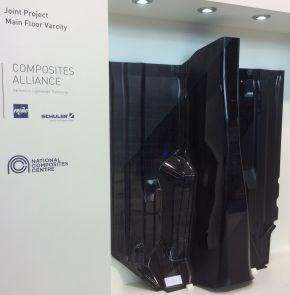 Carbon fiber epoxy composite automotive floor made by Schuler FRIMO NCC