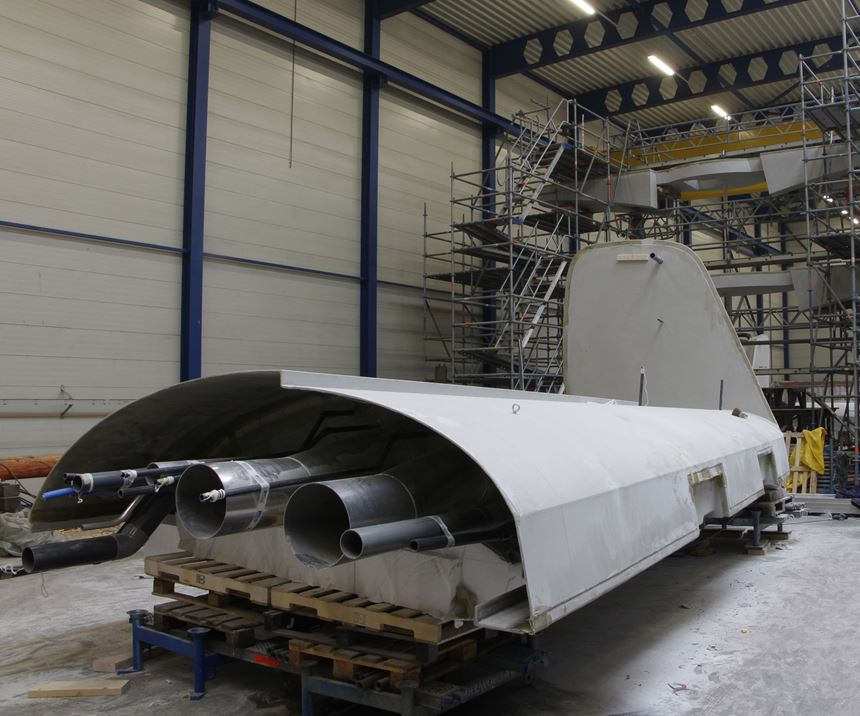 Vabo Composites yacht mast prepared for assembly