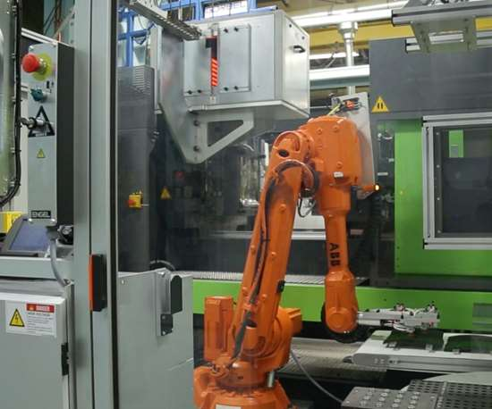 Tri-Mack injection overmolding machine.