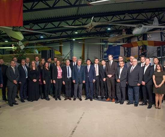 Diamond Aircraft, WanfengAviation Industry team members celebrate Wanfeng's acquisition of Diamond Aircraft.