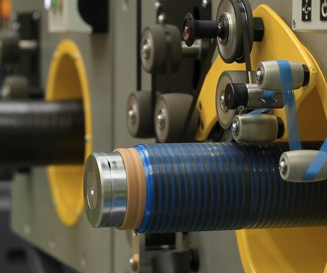 Cygnet Texkimp slitter-spooler machine carbon fiber prepreg spooling head with poly interleaf insertion
