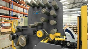 Cygnet Texkimp slitter-spooler machine carbon fiber prepreg spooling head with poly interleaf insertion