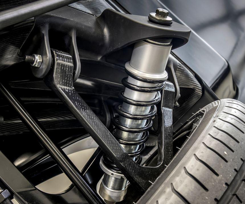 carbon fiber wishbones made by high-pressure resin transfer molding