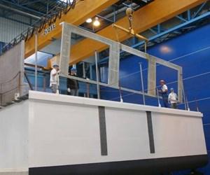 Composite deck reduces river ship draft