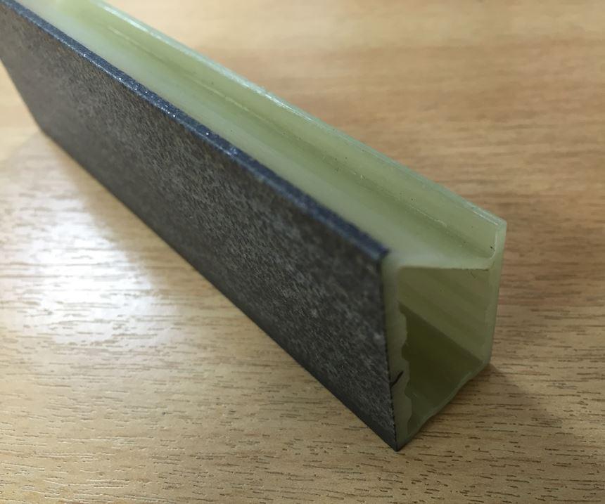 TFP Tecnofire intumescent nonwoven veil in composite pultrusion