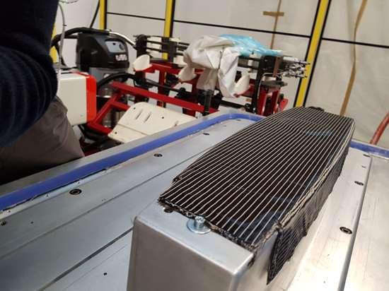 Techni-Modul automated cell rib preform heated tool debulk