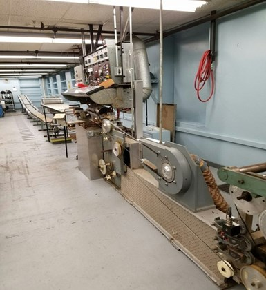 First stage of SMI's two-step process for making ½-inch wide towpreg showing ¼-inch Boron Prepreg Tape Line with 54-Spool Fiber Creel