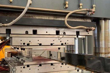 continuous compression molding machine producing composite profile