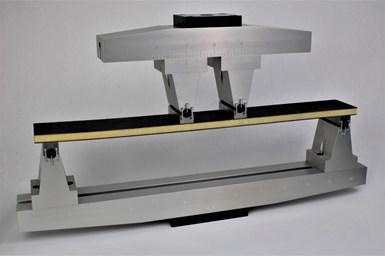 Long beam flexure test fixture and sandwich composite specimen.