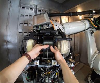 Electroimpact SCRAM system loading carbon fiber tape spool