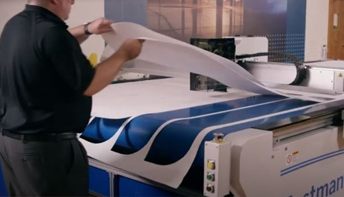 Eastman conveyorized cutting machine