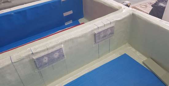 Affan Innovative Solutions hand laid glass fiber prepreg in facade panel mold