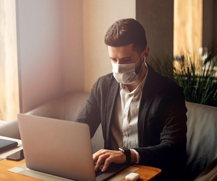 working from home wearing mask coronavirus
