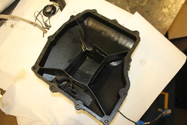 carbon fiber filled composite oil pan for racing vehicle