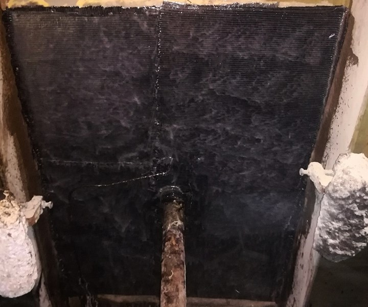 tank bulkhead repaired with carbon fiber reinforcement