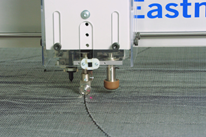 Automated cutting of composite materials