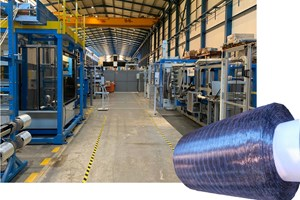 Multiple spools of 50K carbon fiber feed into MTorres dry tape production line