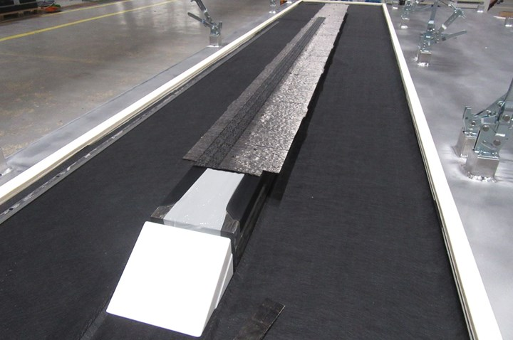 IIAMS project stringer preform on top of hot drape forming tool