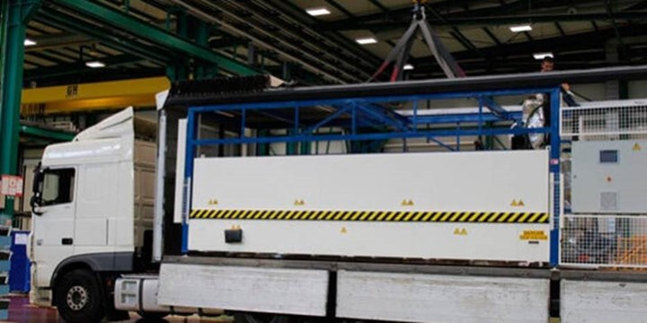 IIAMS project wing box manufacturing equipment on moving truck