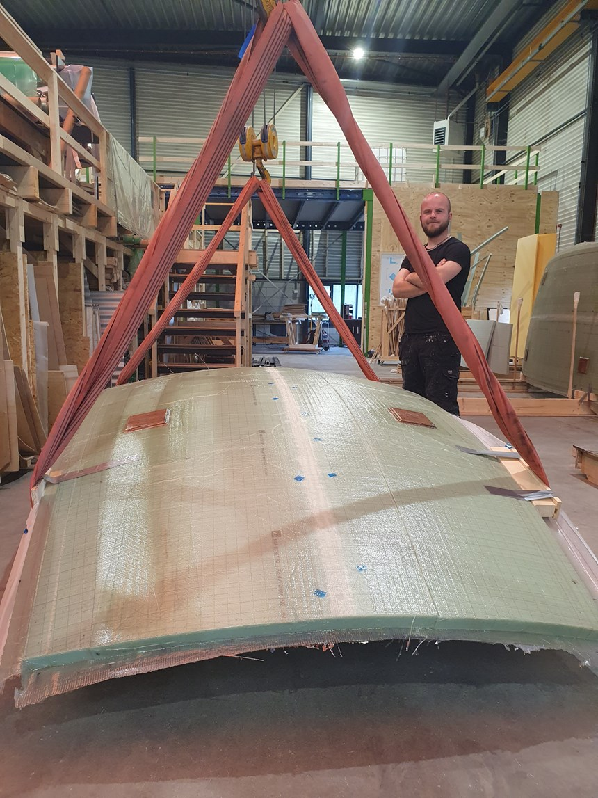 curved composite panel lifted from Curve Works adaptive mold