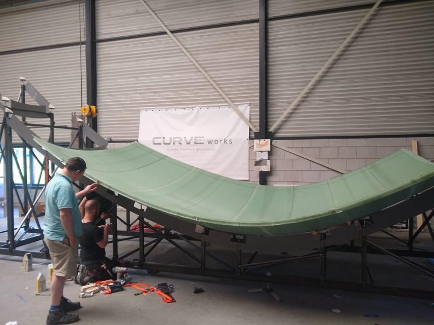 Curve Works composite panel assembly on steel jig