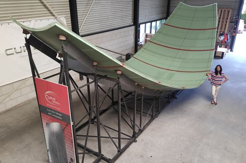 Curved composite sandwich panel production on an adaptive mold